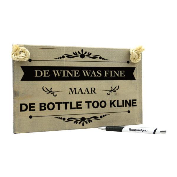Tekst op hout - de wine was fine